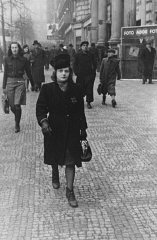Elsa Eisner, marked with a Jewish badge, walks down...