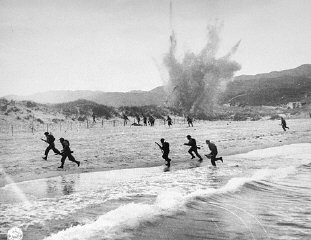 British troops land on the beaches of Normandy on D-Day, the beginning of the Allied invasion of France to establish a second fr