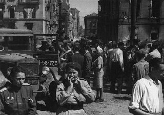 Soviet soldiers in a street in the Soviet occupation...