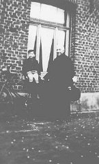 A Jewish child, Jacky Borzykowski, with the priest who placed him in hiding on a farm. Belgium, 1943.