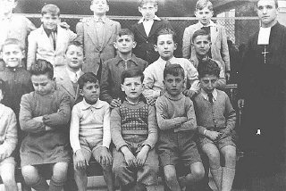 Portrait of a boarding school class in which a Jewish boy was hidden. Rome, Italy, 1943-1944.