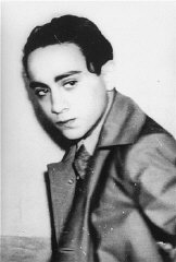 Portrait of Herschel Grynszpan taken after his arrest by French authorities for the assassination of German diplomat Ernst vom Rath. Grynszpan (1921-1943?), born in Hannover, Germany, was the son of Polish Jews who had immigrated to Germany. In 1936 Grynszpan fled to Paris. On November 7, 1938, after having learned of the deportation of his parents from Germany to the Polish frontier, Grynszpan assassinated Ernst vom Rath, the third secretary of the German embassy in Paris. The diplomat's subsequent death two days later was used by the Nazi regime as justification for unleashing the Kristallnacht pogrom of November 9-10. In 1940 Grynszpan was turned over to the Germans by the Vichy government, but the date and place of his death have never been clarified. Paris, France, November 7, 1938.