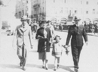 A Jewish family walking down a street.