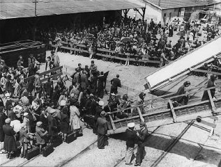 Jewish refugees board the SS Mouzinho for the voyage...