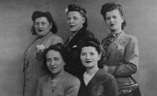 Jewish women wearing the required yellow badges.