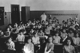 A first-grade class at a Jewish school.