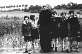 "Father Bruno with Jewish children he hid from the Germans. Yad Vashem recognized Father Bruno as ""Righteous Among the Nations."" Belgium, wartime."