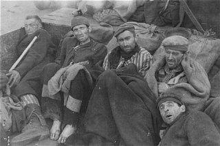 Survivors of the Wöbbelin camp wait for evacuation...