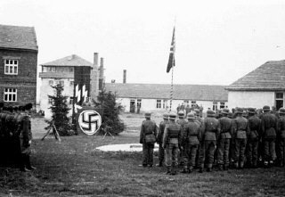 Camp commandant Amon Goeth addresses SS guards.