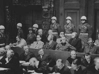 The defendants listen as the prosecution begins introducing documents at the International Military Tribunal trial of war crimin