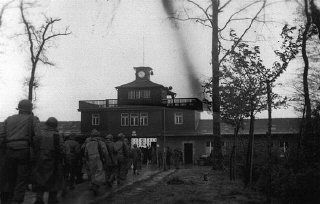 American soldiers enter the Buchenwald concentration camp following the liberation of the camp.