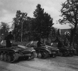 German tanks pass a reviewing stand during a victory parade following the German defeat of Poland.