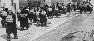 Jews carrying their possessions during deportation...