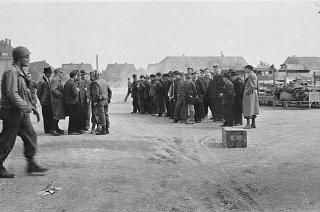 German civilians are assembled by American officials...