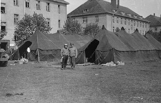 American medical personnel in front of two tents set...