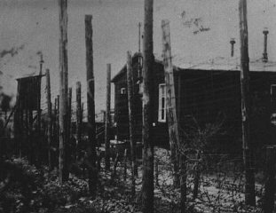 A view of the double row of barbed-wire fences that...