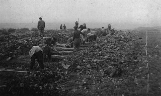 German civilians conscripted from nearby towns dig...