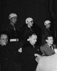 Defendants Karl Doenitz (left), Erich Raeder (center)...