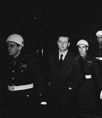 Defendant Hans Fritzsche enters the Nuremberg courtroom...
