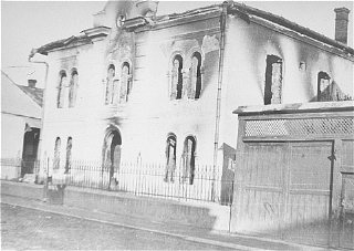 View of the burned-out Malbish Arimim synagogue on...