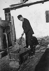 Naftali Saleschutz prepares cement for the foundation...