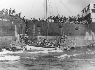 "Aliyah Bet (""illegal"" immigration) ship ""Parita,"" carrying 850 Jewish refugees, lands on a sandbank off the Tel Aviv coast."