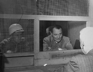 Defendant Hermann Goering consults with his lawyer...