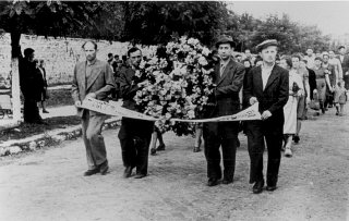 Funeral procession for victims of the Kielce pogrom...