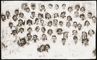 Group portrait of the members of the Zionist pioneer youth group, Ha-Shomer ha-Tsa'ir Hachshara.