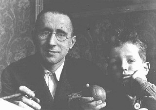 Bertolt Brecht (left), Marxist poet and dramatist, was a staunch opponent of the Nazis. He fled Germany shortly after Hitler's rise to power. Pictured here with his son, Stefan. Germany, 1931.