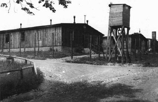 A watchtower and barracks at the Ohrdruf subcamp of...