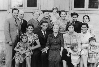 Three generations of a Jewish family pose for a group photograph.