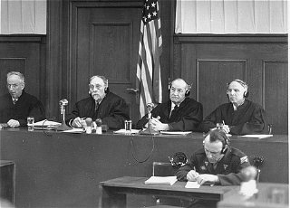The four judges of Military Tribunal III hearing the...