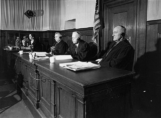 The judges in the courtroom during the Hostage Case. From left to right are Edward F. Carter, Charles F. Wennerstrum, and George J. Burke.