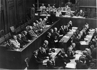 The Krupp Trial defendants in the dock (left) and their...