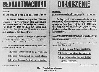 A Nazi decree issued in October 1941, in German and Polish, warns that Jews leaving the ghetto, or Poles who aid them, will be e