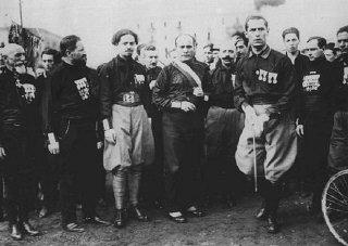 Italian Fascist leader Benito Mussolini (center) with...