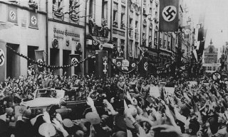 Adolf Hitler (standing at front of car) enters Danz...