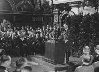 Adolf Hitler addresses German officers after the occupation...
