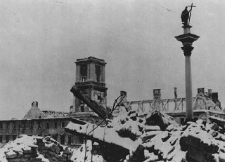 The Sigismund Monument stands amid rubble in the Polish...