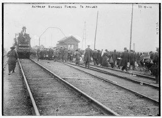 Refugees from Antwerp, Belgium, walk along railroad...