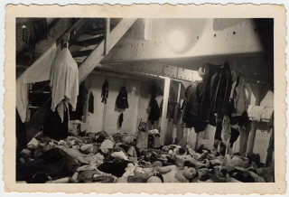 Jewish refugees crowd together in the sleeping quarters...