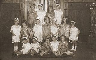 Group portrait of children dressed in Purim costume...