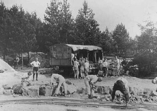 Forced laborers cut quarried stones outside the Buchenwald concentration camp.