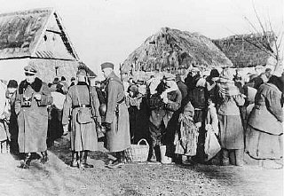 German soldiers expel Polish inhabitants from the Zamosc area.