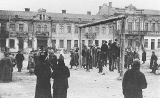 Polish partisans are hanged by the Nazis.