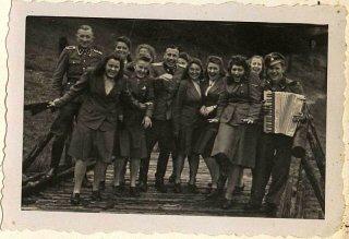 The SS female auxiliaries (Helferinnen) run down a...