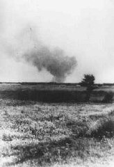 Distant view of smoke from the Treblinka extermination camp, set on fire by prisoners during a revolt.
