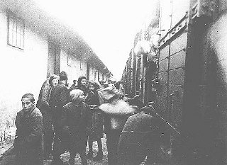 Jews forced to board a train to the Danube River port of Lom, from where they were sent to the Treblinka extermination camp duri