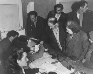 Checking identity cards of Jews who fled eastern Europe...